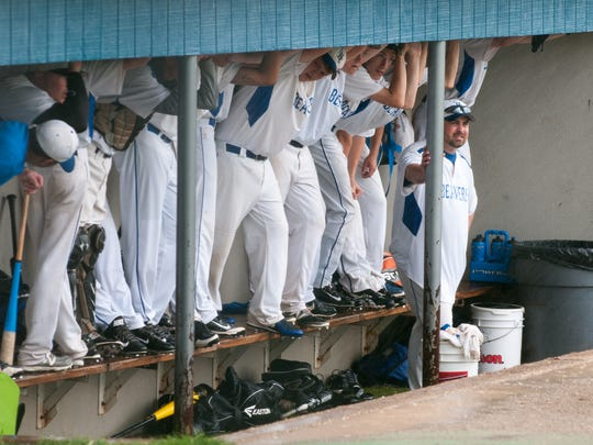 Harper Creek baseball players wait out heavy rains