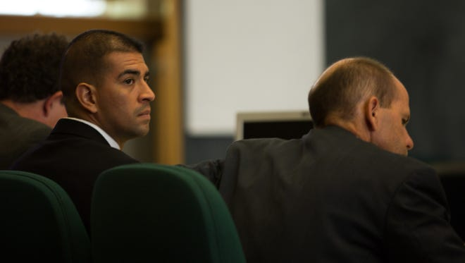 Former Las Cruces Police Officer Richard Garcia sits next to his attorneys, Jerome O'Connell, left, and Jess Lilley, during his trial Monday June 27, 2016. Garcia is accused of beating Ross Flynn in a police holding cell on Dec. 23, 2014.