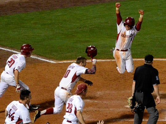 Arkansas' Rick Nomura jumps after scoring against Tennessee in the ninth inning of their game in the SEC Tournament on May 19 in Hoover, Ala. Trey Killian didn't get the decision, but held the Vols to one run over 72/3 innings in that start.
