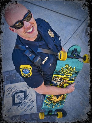 """Officer Joel Zwicky of the Green Bay Police Department says he's the first cop """"in the world"""" to opt for a skateboard over a squad car. The policeman uses the board for an average of 45 minutes each work day."""