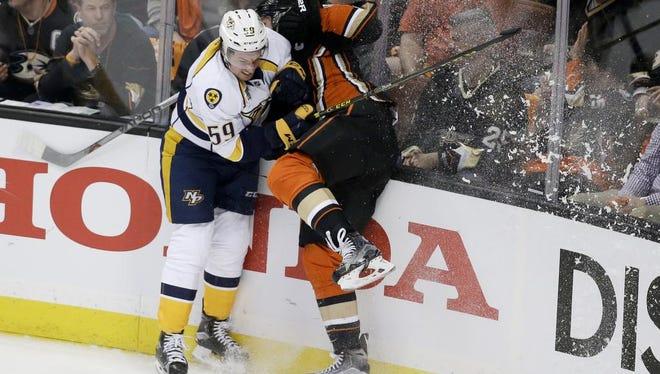Predators defenseman Roman Josi, left, checks Anaheim Ducks center Ryan Getzlaf during the first period.