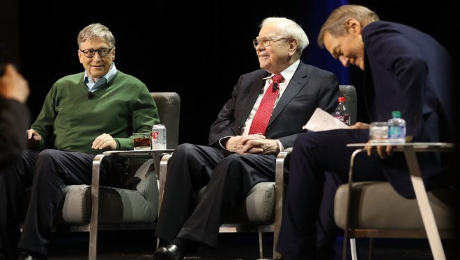 Bill Gates and Warren Buffett speak with journalist Charlie Rose at an event organized by Columbia Business School on January 27, 2017 in New York City.