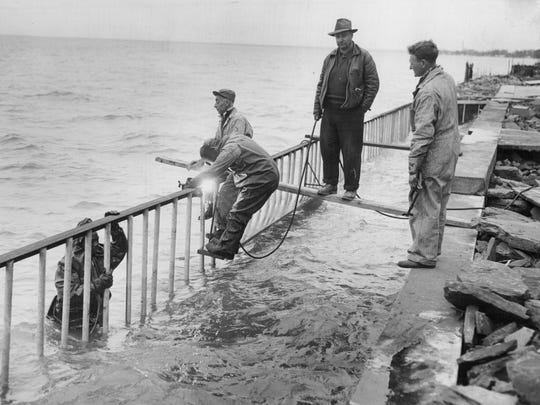 Breakwater repair near Edgemere Drive in Greece during the flooding of April, 1952.