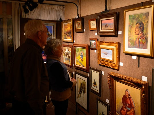 Dick and Bev Sherman of Big Fork visit a room at the March in Montana show on Friday.