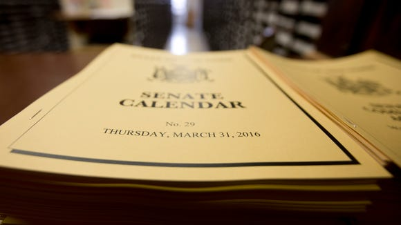 Senate calendars are stacked up on a counter at the