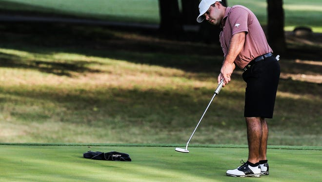 Chris Hall takes a shot on the first greens during the San Angelo Country Club Men's Partnership Thursday, June 22.