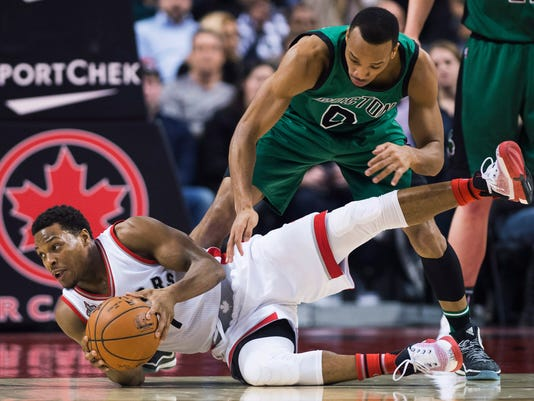 Toronto Raptors guard Kyle Lowry (7) battles for the ball against Boston Celtics guard Avery Bradley (0) during the first half of an NBA basketball game in Toronto on Wednesday, Jan. 20, 2016. (Nathan Denette/The Canadian Press via AP)