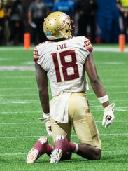 Florida State junior wide receiver Auden Tate dejectedly