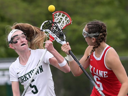 From left, Yorktown's Ciara Frawley (5) and Fox Lane's