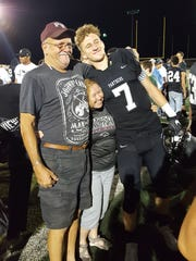 Pine View's Dylan Hendrickson poses for a picture with his grandparents Jud and Renea Hendrickson after a home football game.
