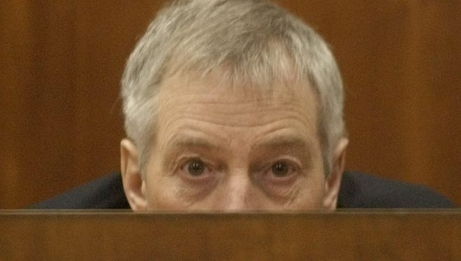 Multi-millionaire murder defendant Robert Durst peers over the witness box during a break in his testimony Thursday, Oct. 23, 2003, in Galveston, Texas. The son of a New York City real estate tycoon, Durst is accused of murder for killing a neighbor at a low-rent Galveston apartment house where they both lived, then dismembering the victim and throwing the body parts into Galveston Bay.