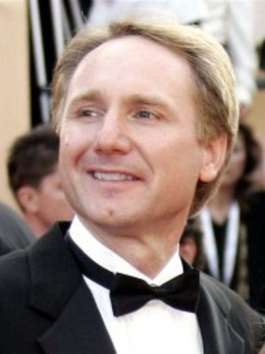 "Author Dan Brown, left, arrives for the screening of ""The Da Vinci Code"" in Cannes, France in 2006. (AP Photo/Jeff Christensen)"
