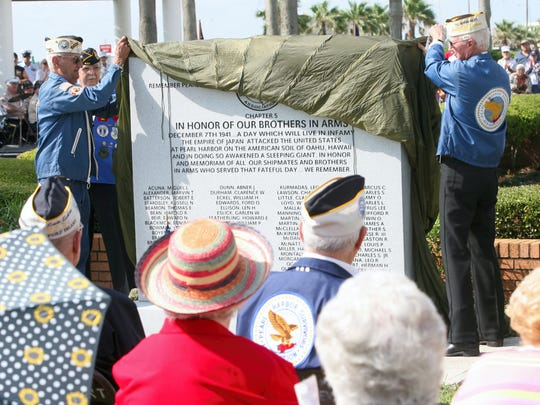 Pearl Harbor survivors Harry Ogg (left) and W.W. Loyd unveil a Pearl Harbor Memorial marker at the beginning of the Memorial Day Observance ceremony at Sherrill Park in 2007.