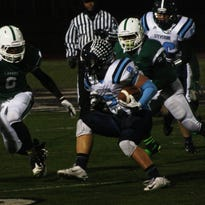 Livonia Stevenson's Andrew Cyburt pounced on the ball at the West Bloomfield 10-yard line following a muffed Lakers punt. The Spartans scored one play later.
