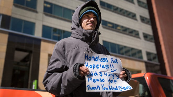 Mike, 32, is homeless, living on the streets of Cincinnati for the past three years. He's a graduate of Anderson High School. He said he hasn't been able to find a job.  Chico Lockhart, a social worker employed by DCI (Downtown Cincinnati Inc) tries to help people like Mike, but they need to be willing to get an ID and accept the help Lockhart offers.