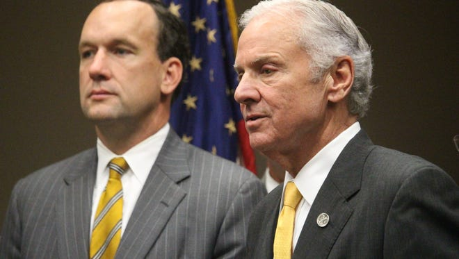 Gov. Henry McMaster, right, speaks Monday in Greenville about his support for legislation sponsored by Rep. Bruce Bannister, left, to prevent sanctuary cities for illegal immigrants from being created in South Carolina.