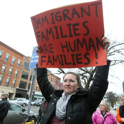 Megan Smith, of Rochester, takes part in a rally outside