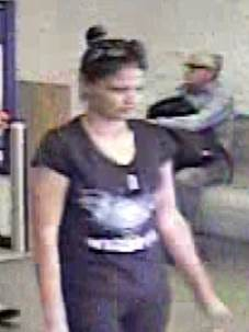 An image from a store security camera shows a woman suspected in the burglary of an elderly woman's home on Aug. 7.