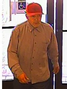 A surveillance camera shows a man suspected of robbing a Tempe credit-union branch on March 6, the FBI said.