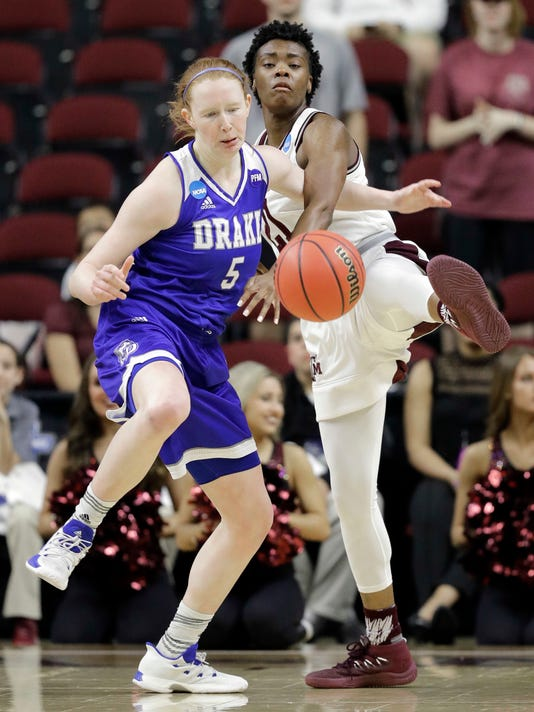 Texas A&M's Jasmine Lumpkin (21) knocks the ball away from Drake's Becca Hittner (5) during the first half of a first-round game in the NCAA women's college basketball tournament in College Station, Texas, Friday, March 16, 2018. (AP Photo/David J. Phillip)