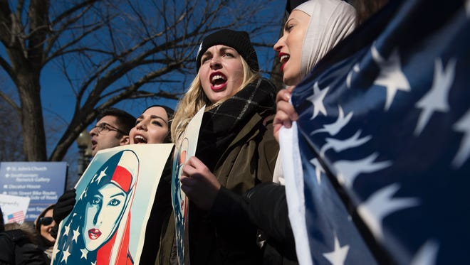 Demonstrators protest against President Trump's ban on refugees entering the U.S. outside the White House on Saturday.
