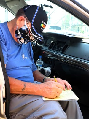Richard Wiley sits in his car as he fills out an intake interview sheet to drop off with his taxes forms, Monday, June 15, 2020, at the RSVP Center, 401 N 13th St., requesting free tax preparation and electronic filing for his federal and state taxes. The RSVP Center is only allowing drop off tax preparation for seniors 60-years-old or older on Monday and Wednesday, 9 a.m. - noon and qualifying individuals of any age, Monday, 1 - 6 p.m. and Wednesday, 1 -4 p.m. For additional information call 782-2525.