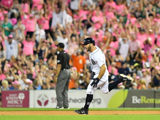 Tigers' Tyler Collins rounds the bases on his three-run