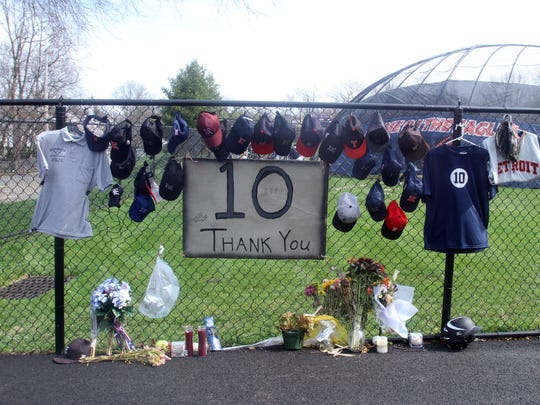 Uniforms, caps, flowers, and candles form a memorial to longtime Eastchester High School baseball coach Dom Cecere at the school's baseball team. Before the start of the team's home opener against Sleepy Hollow April 13, 2017, the team held a ceremony to honor Cecere, who died earlier this month.