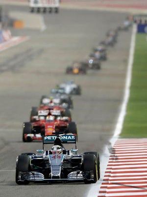 Mercedes driver Lewis Hamilton of Britain leads during the Bahrain Formula One Grand Prix at the Formula One Bahrain International Circuit in Sakhir, Bahrain, Sunday, April 19, 2015. (AP Photo/Luca Bruno)