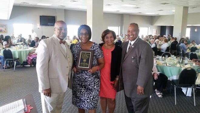 (From left) Bridgeton Mayor Albert B. Kelly; Vandella Bates of Gateway Community Action Partnership; Judy Truman, project director, Retired and Senior Volunteer Program of Cumberland County; and Jack Surrency, RSVP board member.