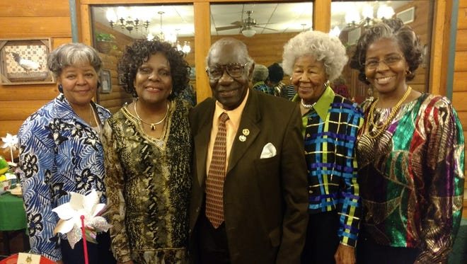 Hostess Sylvia Petties, President Clenteria Drayton, guest speaker Dr. Osiefield Anderson, hostess Margaree Elkins and Rev. Angie Whittaker pose for a picture after anniversary dinner.