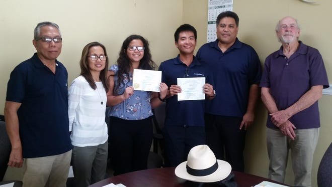 The Guam Board of Registration for Professional Engineers, Architects & Land Surveyors congratulate Two Engineer Interns who have successfully passed the NCEES Fundamental of Engineering Exam on September 7 and Oct. 4. Board members pictured from right: Philip I. Villanueva, Public Member; Maria Elisabeth V. Cristi, PE, Sec. & Tres.; Joresa Mae Salucop Ollet, EIT; Ken Villarico Nasatsu, EIT; Gabriel Jugo,PE, SE, Chairman; H. Mark Ruth,RA,FAIA, Vice Chair.