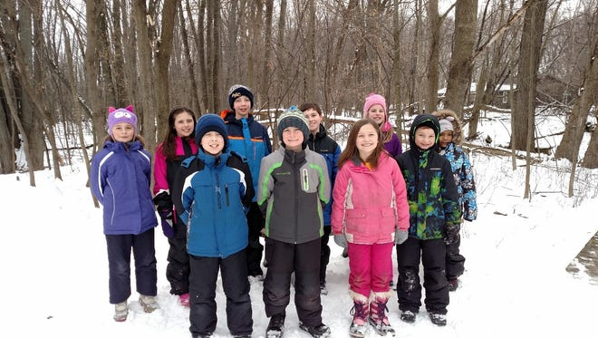 The fourth-grade students at St. Mary Elementary School enjoyed visiting Heckrodt Wetland Reserve learning about animal tracks and winter adaptations. Pictured are, first row, from left, Adam Nutini, Zack Beyer, Haylie Lynch, Thomas Siems; second row, Meagan Mccune, Erin Blaney, Pete Krautkramer, Preston Short, Mary McCurdy and Makaya Klessig
