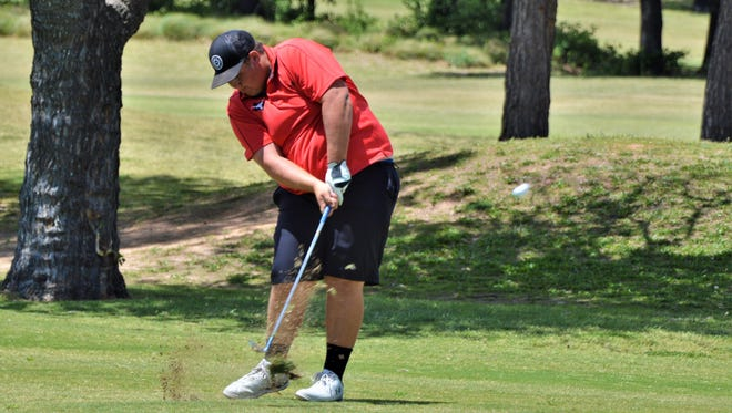 Eastland's Zane Brooks hits his approach shot on the 18th hole in the second round of the Region-1-3A tournament on Tuesday at Shady Oaks Golf Course in Baird.