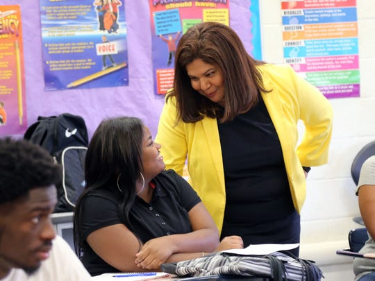 EAA district  chancellor Veronica Conforme talks to Lexus Sampson,17, a senior in the English Language Arts class  at Henry Ford High School in Detroit on the first day of school on Tuesday, September 8, 2015.