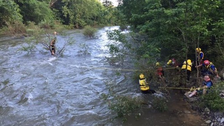 Emergency personnel work to rescue Christian Gutierrez,
