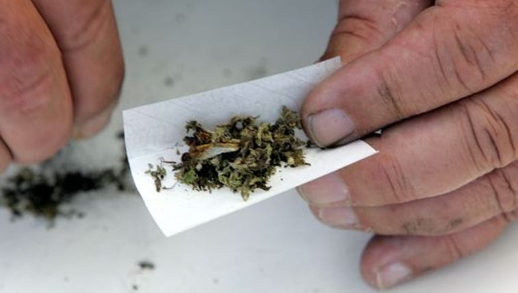 marijuana being rolled into a joint