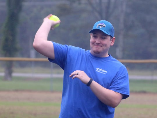Shane Longoria throws the first pitch at a softball