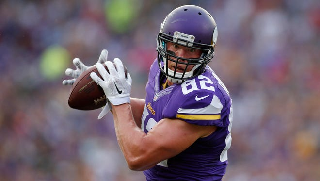 Minnesota Vikings tight end Kyle Rudolph (82) catches a pass against the Oakland Raiders in the first quarter at TCF Bank Stadium, Aug. 8, 2014.