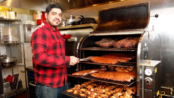 Chef-owner Douglas Lo Cicero with his smoker at D&A Smokehouse, a new barbecue restaurant in Scarsdale, Feb. 18, 2014.