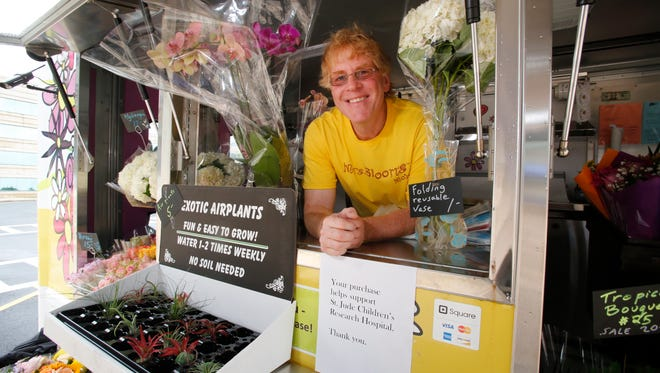 Ari Shapiro, owner of Mrs. Bloom's Mobile flower shop at one of his stops at the Pepsi corporate park in White Plains on July 14, 2014.