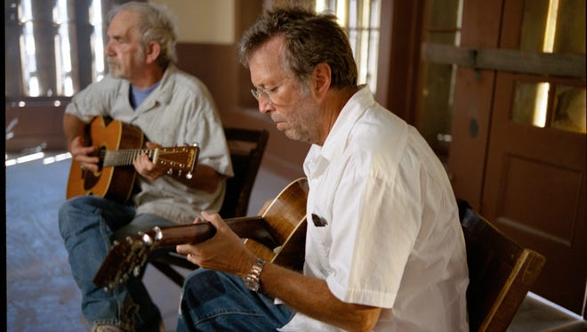 Musicians Eric Clapton, right, and the late JJ Cale.