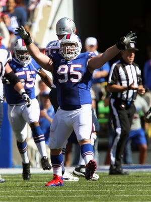 Bills DT Kyle Williams has 35.5 career sacks. Here he celebrates a special one, against Tom Brady.