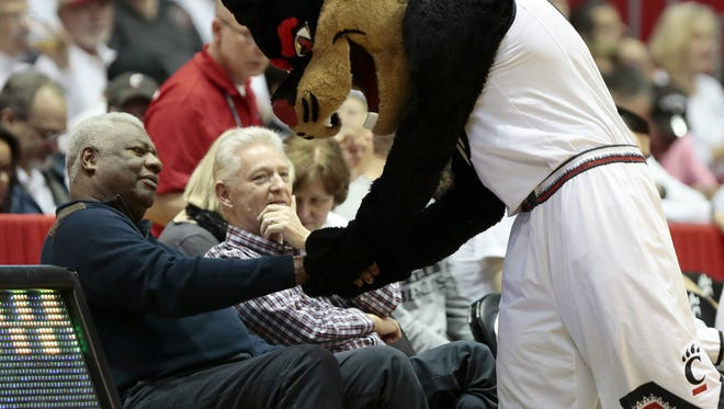 The UC Bearcat shakes hands with Bearcats legend Oscar Robertson during a Feb. 20 win over UConn.