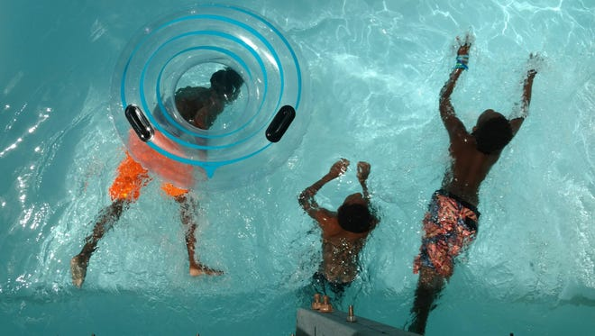 Three boys float the lazy river at Sun Splash Family Waterpark in Cape Coral.