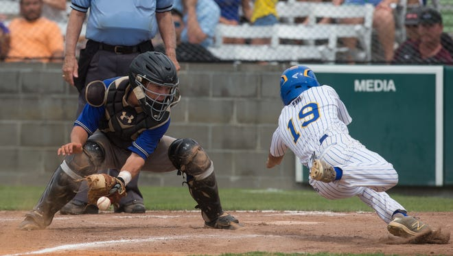 Moody's Brock Hergens sleds home safe after Kerrville Tivy's catcher Rody Barker misses a catch during the fourth inning of the 5A Regional semifinals at Cabaniss Baseball Field on Saturday, May 27, 2017