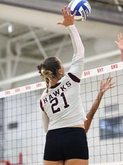 Petra Jerabkova goes for a spike at Sacred Heart University in Fairfield, Conn. on Sept. 7, 2013.