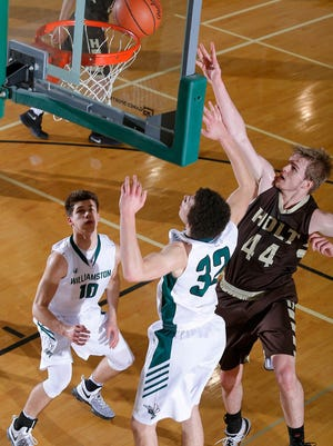 Holt's Jaron Faulds, right, and Williamston's Mitchell Cook, left, and Sean Cobb (32) reach for a rebound Tuesday, Feb. 28, 2017, in Williamston, Mich. Holt won 69-52.
