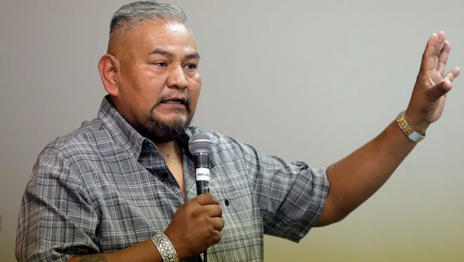 """In this Aug. 22, 2016, photo, Navajo Nation member Davis Filfred speaks during a meeting with the Navajo Tribal Utility Authority at the Red Mesa Chapter, near Montezuma Creek, Utah. Filfred is among the tribal members hoping a federal judge on Wednesday, Sept. 22 grants the group's request for an injunction that would require the county to restore polling places for the November election and staff them with bilingual workers who can help Navajo speakers. """"A lot of Navajos don't understand the mail-in ballot,"""" said Filfred. """"They would rather go to a polling place. That's what they're accustomed to and they want that back."""