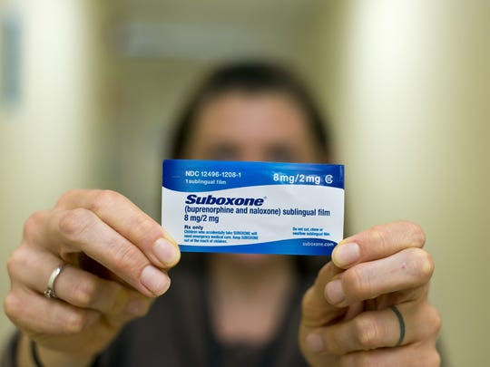 Megan Detweiler R.N., head nurse at the Howard Center's Chittenden Clinic in South Burlington on Oct. 30, 2014, with an 8 milligram Suboxone strip, which is used to treat opiate addicts.